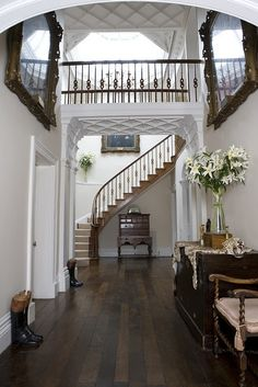 I like the bridge in the house idea for a foyer... Just a different staircase layout