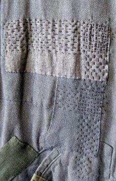 grey, texture, neutrals, stitching, embellishment, scraps, graphic impact, subtle repin: Boro mended (japanese technique) piece of clothing.