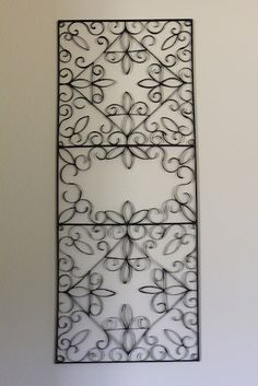 These are made out of toilet paper - can you believe it?! Looks like wrought iron.