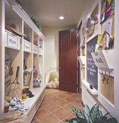 Mudroom.  Space for each family member (include some empty for guests).  Extended bottom ledge as bench to sit on.