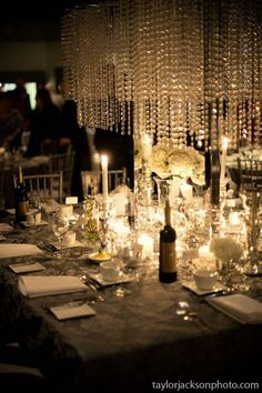 Lots of glass and crystal gives it an icey look but the candles make it feel very warm and intimate.  DIY wedding, Meaghan and Steve, Taylor Jackson Photography
