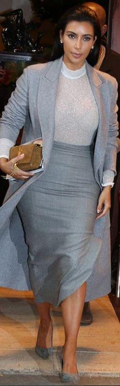 Kim Kardashian: Coat – Celine  Purse and shoes – Saint Laurent