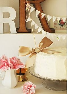 bunting on a cake!!  omg if I was getting married, I would so want this as my topper, maybe with our names stamped on each one.  adorable.