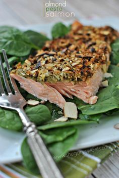 Almond Pesto Salmon - Shugary Sweets.  [Turn on broiler. Roughly chop 3/4-cu sliced almonds and toss with1/2-cu panko.  On sprayed, foil-lined sheet:  salmon, top with pesto, then almond mix. Spray tops. Broil 7min on middle rack, then 2min on top rack. -hn]