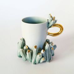 Sculpted Porcelain Crystal Cup and Suacer with Gold Luster