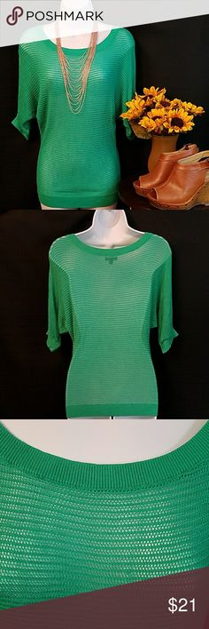 EXPRESS Green loose knit dolman sleeve sweater Beautiful green colored loose knit (see-through) dolman sleeve sweater. Has some stretch.  Size XS 100% rayon - hand wash  In very good condition  Approximate measurements: Armpit to armpit = 18in; Shoulder to hem = 27in. Express Sweaters