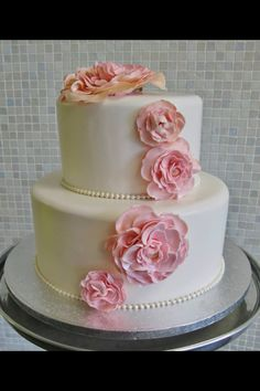 Two tier wedding cake. Small and simple. White cake with purple ...