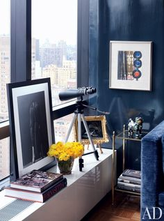 Arrayed in a of Todd Alexander Romano's Manhattan living room corner are books, flowers, and leaned-up art | archdigest.com