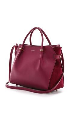A gently-gathered handbag with velvety suede gussets.