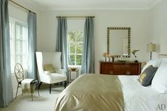 20 Great Shades of White Paint and Some To Avoid | lovely classic bedroom by Victoria Hagan | love the gray-blue silk drapes and pale colors | wall color Pratt and Lambert Seed Pearl