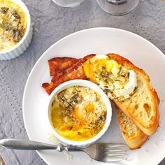 The simplicity of these Parmesan baked eggs is what makes them so amazing! Butter, shallot, herbs, garlic, eggs, and cream. | pinchofyum.com