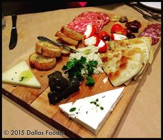 Being back in Dallas means another installment of #IndefiniteCheeseboards Monday! Tonight I got to try one of the first boards our group reviewed 73 weeks ago Tizikis #Greek #cheeseboard. Several in our group still rank it amongst the best of the 17 Dallas #cheeseboards weve reviewed on this hashtag in the 93 weeks since it started. Now I see why It has unique inclusions such as grape leaf wrapped Dolmades pureed artichoke dip herbed pitas gin & juice lamb salamis and drizzles of olive oil…