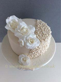 This is a first wedding anniversary cake, a smaller version of a wedding cake I made, for lovely friends of mine.