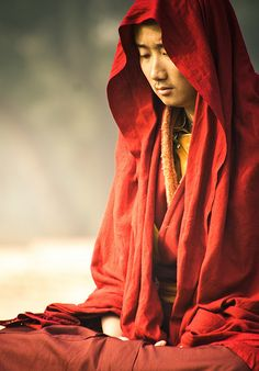 Buddhist monk, meditating.