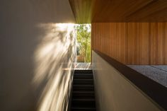 View towards the outside at the top of a staircase. Picornell House by John Pawson.
