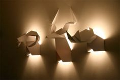 """""""Origami's hunter"""" – origami hunting trophy lamps by Verónica Posada (Si Studio), a Chilean Industrial Designer"""