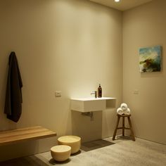 Our serene change rooms feature a painting by Tod Hunter, beeswax candles from Milan and recycled oak bench seats