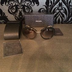 AUTHENTIC PRADA SPR16Q SUNGLASSES BRAND NEW Brand new,all packaged,never worn,comes with PRADA box , PRADA sunglasses case , Sealed PRADA cleaning cloth . Distinctive hexagonal silhouette featuring gradient lenses,integrated nose piece, logo temple . Frame material:Acetate , Lens material : plastic , Coating :100%UV Protection , Lens dimensions: width 56mm Bridge 19mm,Arm 135mm , MADE IN ITALY . THEY ARE NORMAL PRICE ON THE PRADA! Great deal ! Prada Accessories Sunglasses