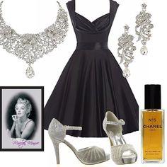 Outfit ispirato ad un'icona senza tempo: Marylin Monroe. Abito nero, con ampio scollo e gonna a campana. Sandalo argento. Vistosi orecchini e collier in cristallo bianco. Profumo Chanel n. 5. Specchio stampato con cornice.