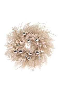 A glitter-dusted finish and classic ball ornaments intensify the festive charm of an elegant holiday wreath