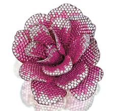 """PINK SAPPHIRE AND DIAMOND BROOCH, """" CAMELLIA"""", MICHELE DELLA VALLE Realistically designed as a camellia, set with numerous circular-cut pink sapphires and brilliant-cut diamonds, mounted in white gold and titanium, signed Michele della Valle and numbered, case ."""
