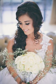 Absolutely stunning - from the simple braid and loose curls to the smoky eye and slightly-wild bouquet