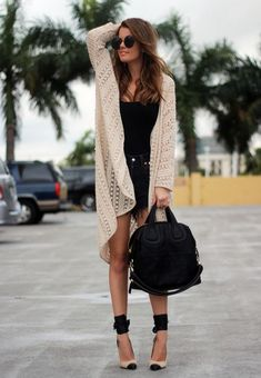 Norwegian style blogger Annette Haga [Nette Nestea] in a Nastygal cardigan, Never Naked black studded shorts, Givenchy bag, and Isabel Marant shoes.