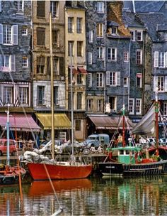 Honfleur, France is a gorgeous town with 16th - 18th Century townhouses around the harbour. Monet painted here as well as many other artists.