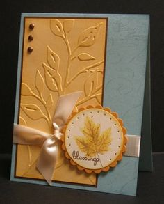 handcrafted card for Color Throwdown: Color Throwdown #13: So Saffron, Baja Blue and More Mustard ... blue card base ... panele with embossing folder leafy branches ,,. small circle the two tone maple leaf ,,, beautiful card !!