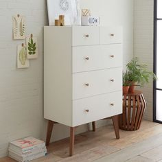 High + mighty. Crafted of stained wood veneer, the Tall Storage Dresser provides classic, clean-lined bedroom storage. Angled solid wood legs and drawer pulls in an almond finish give it a light, airy look.