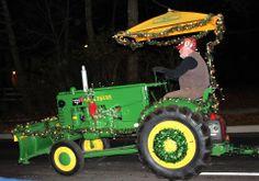 Mahaffey Farms riding John Deere in the Hometown HoliDazzle parade, 2013. Photo by Sarah Newton.   http://www.clintoncountyohio.com/ #Ohio #parades #festivals #families #holidays2013 #VisitClintonCounty — Clinton County in Southwest Ohio.