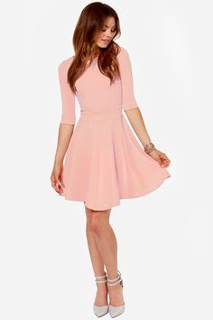"""Lulus Exclusive! The Just a Twirl Light Pink Dress wants you to stop standing still and start spinning! Stretchy knit is thick enough to wear on a chilly day as it hugs your curves down half sleeves and a fitted bodice with a rounded neckline and unique seam details. A banded waist is just the beginning of a full skirt that flares to twirl-worthy perfection. Hidden back zipper. Unlined. Model is 5'9"""" and is wearing a size small. 65% Rayon, 30% Nylon, 5% Spandex. Hand Wash Cold or Dry Clean."""