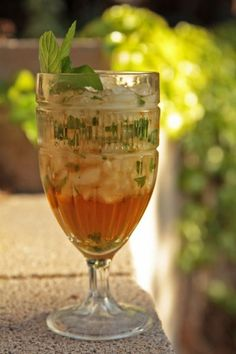 Mint Julep ~ a Southern drink made with mint leaf, bourbon, sugar, and water. Traditionally, spearmint is the mint of choice, particularly in Kentucky. It is the 'official' drink of the Kentucky Derby.