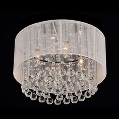 Light any room in elegant style with this gorgeous four-light white crystal chandelier. The one-tier chrome and crystal chandelier features a sturdy iron base and dazzling crystals that dangle down from the luminous white cotton-thread shade.