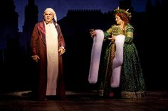 """Edward Gero as Ebenezer Scrooge and Anne Stone as the Ghost of Christmas Present in the new Ford's Theatre production of Dickens's """"A Christmas Carol,"""" directed by Michael Baron. Photo by T. Charles Erickson. A Christmas Carol, by Charles Dickens, adapted by Michael Wilson, directed by Michael Baron at Ford's Theatre 11/22/09 Lighting Design: Rui Rita Set Design: Lee Savage Costume Design: Alejo Vietti (C) T Charles Erickson tcepix@comcast.net pa.photoshelter.com/c/..."""