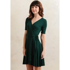 Ruche Larchmont Wrap Dress ($25) ❤ liked on Polyvore featuring dresses, green, green fitted dress, short-sleeve dresses, ruched wrap dress, surplice dress and green wrap dress