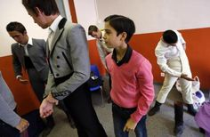 Solal (C), a twelve-year-old toreador apprentice of the Nimes bullfighting school, nicknamed Solalito, helps young toreadors get dressed before a beginner's bullfight (becerrada) at the bullring of Rodilhan, near Nimes, October 27, 2013.  REUTERS/Jean-Paul Pelissier