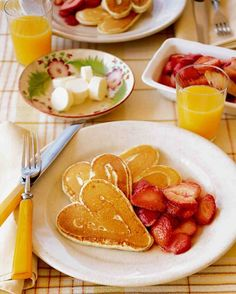 Kick off Valentine's Day with heart-shaped pancakes.