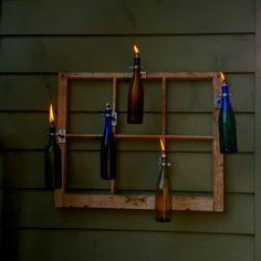 Wine bottle tiki torches / #wehavealotofoldwindowsinthegarage