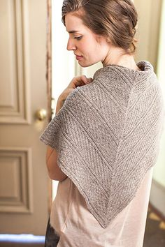 This is a printed pattern that requires shipping. A clever combination of simple knits and purls create the Guernsey Triangle's lush texture. Knit in airy Loft, this shawl is perfect to warm up chilly