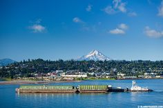Tidewater Barge cruises by Hood River and Mt. Hood