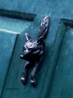 Wrought iron door knocker shaped like a fox, on old door in the small village of Tulla, Co Clare, Ireland.