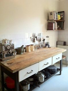 Kitchen Food Prep Counter; Wooden Countertop on metal frame base with drawers and open shelf for cookware storage below