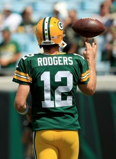 Aaron Rodgers Photos Photos - AAron Rodgers #12 of the Green Bay Packers warms…