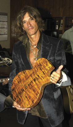 Joe Perry..smiles..--This world is really awesome. The woman who make our chocolate think you're awesome, too. Our chocolate is organic and fair trade and full of amazing flavor. We're Peruvian Chocolate. Order some today on Amazon! Woman owned! http://www.amazon.com/gp/product/B00725K254