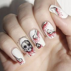 Top 10 DIY Halloween Nail Art Ideas 2016   Unique and Sexy Spooky Mani by Makeup Tutorials at http://makeuptutorials.com/diy-halloween-nail-art-design-2016/