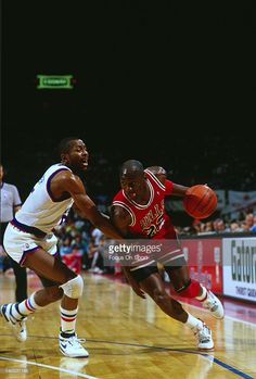 Michael Jordan #23 of the Chicago Bulls drives on Darrell Walker #5 of the Washington Bullets during an NBA basketball game circa 1990 at the Capital Centre in Landover, Maryland. Jordan played for the Bulls from 1984-93 and 1995 - 98.