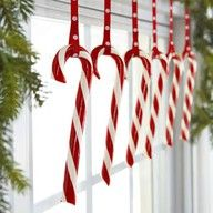 Candy Pane    Hooked onto polka-dot ribbons, a row of candy canes livens up a bough-decked window.    Read more: Red and White Christmas Decorations - Red Christmas Decorating Ideas - Good Housekeeping