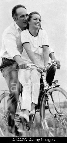 Michel Piccoli and Romy Schneider ride a bike.