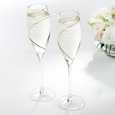 Gold Swirl Champagne Flutes | #exclusivelyweddings...perfect filled with Jordan almonds and covered with a tie-string jewelry satchel